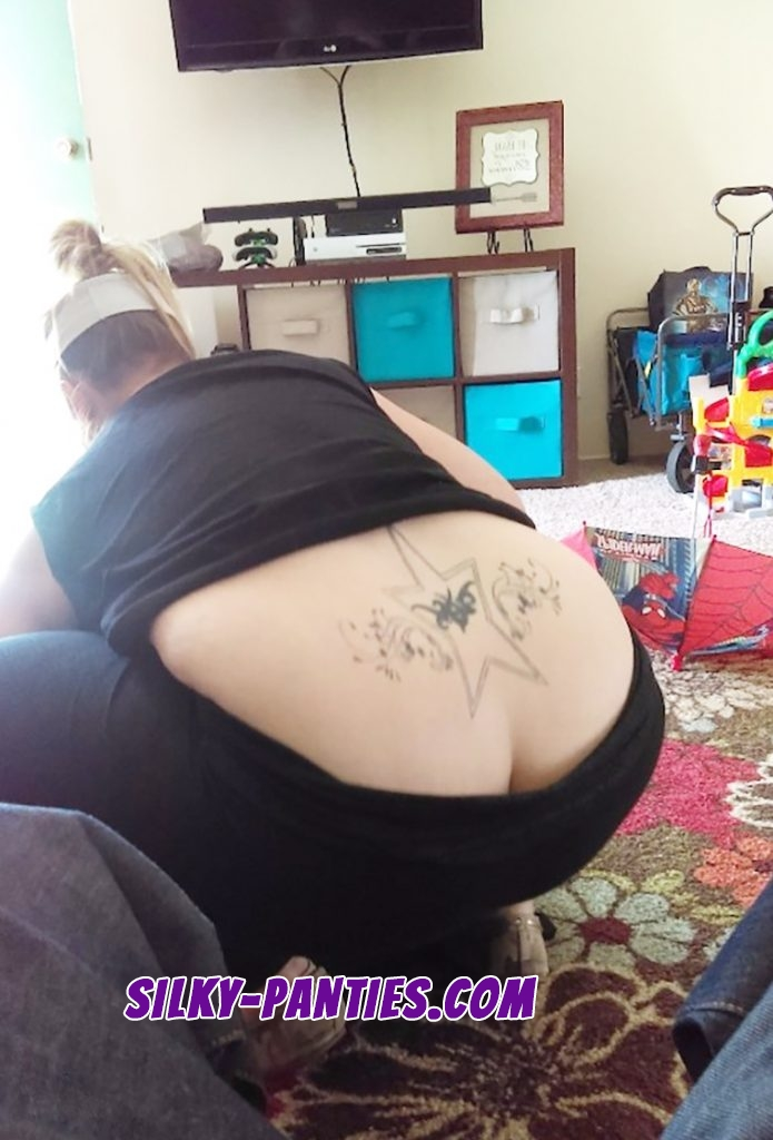 Butt crack and tramp stamp tattoo seen by voyeur